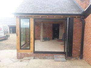 3 Aluminium windows and bifold doors into oak extension