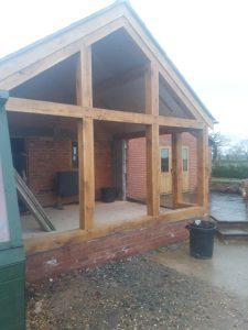 2 Aluminium windows and bifold doors into oak extension