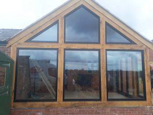 4 Aluminium windows and bifold doors into oak extension
