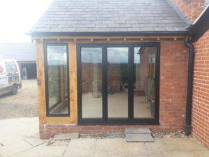 5 Aluminium windows and bifold doors into oak extension